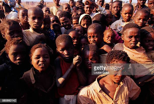Young refugees in Camacupa Angola wait to receive blankets from a Medecins sans Frontieres distribution site After Angola gained independence from...
