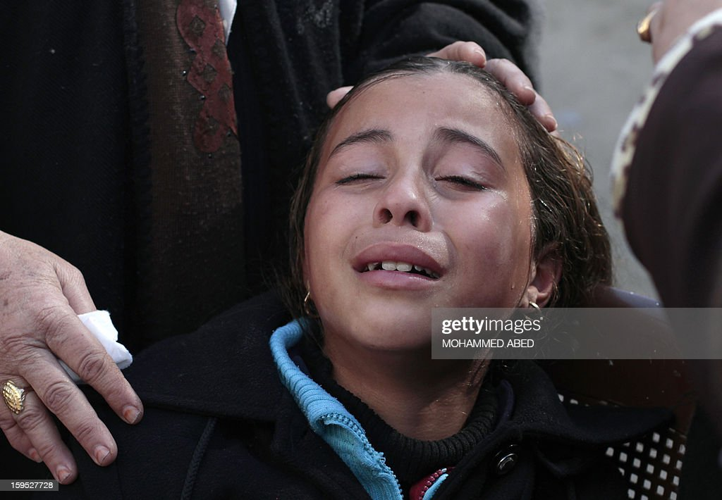 A young relative of Palestinian Mustafa Abu Jirad, a 21-year-old farmer, cries during his funeral in the northern Gaza Strip on January 15, 2013. Jirad was shot by Israeli troops on January 14, and died of his wounds in hospital, a Palestinian medical official told AFP. The Israeli military had no comment on the reported shooting.