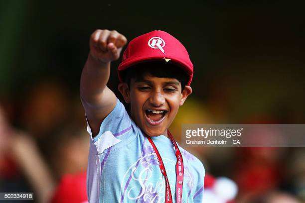 A young Renegades fan shows his support during the Big Bash League match between the Melbourne Renegades and the Sydney Sixers at Etihad Stadium on...