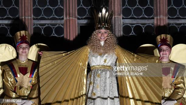 Young resident Benigna Munsi dressed as the Nuremberg Christkind stands at the balcony of the Frauenkirche Church during the opening of the...