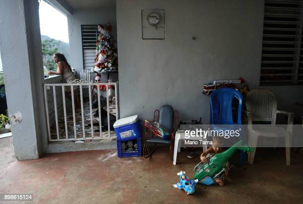 Young residents gather at their family's home still without electricity on Christmas day on December 25 2017 in Morovis Puerto Rico The family said...