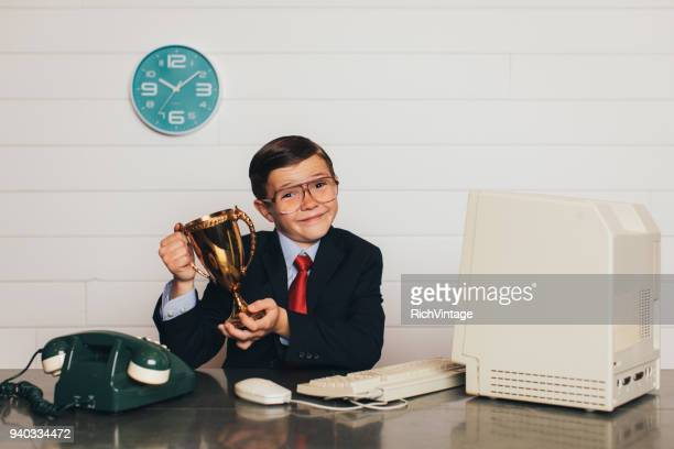 Young Retro Business Boy in Office with Trophy