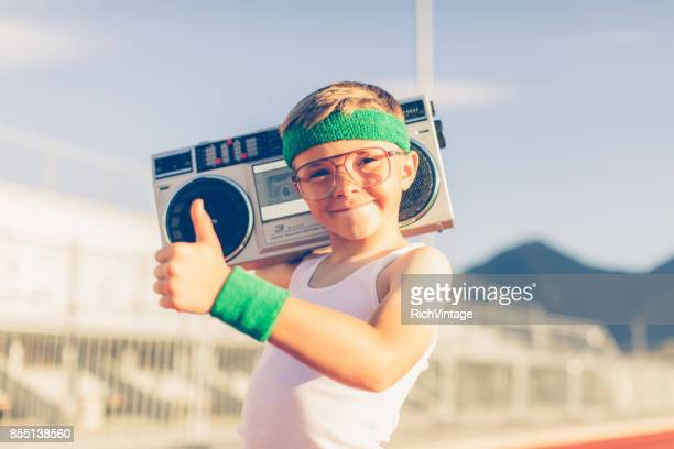 Young Retro Fitness Boy Listening to Music