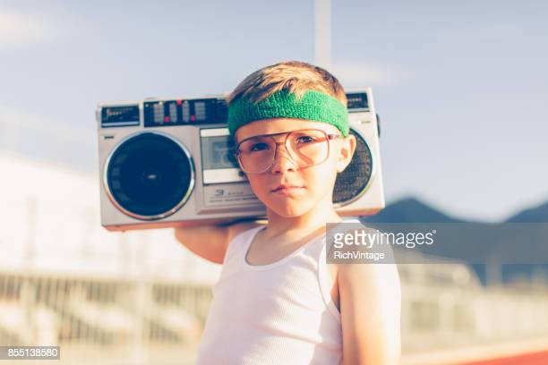 young retro fitness boy listening to music - radio stock pictures, royalty-free photos & images