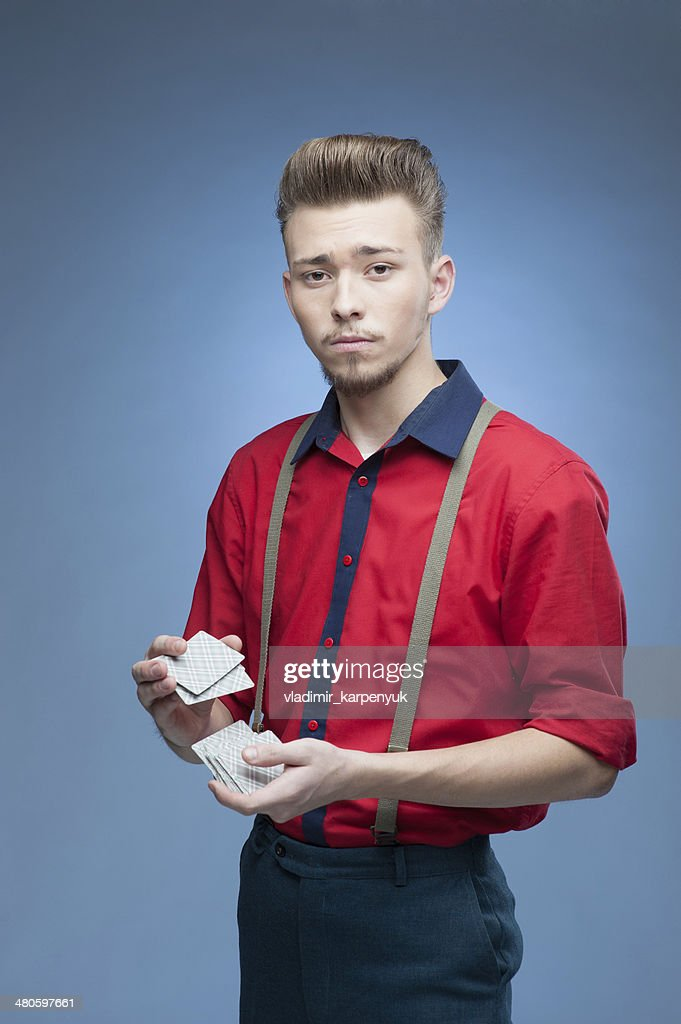 young retro man shaking playing cards : Stock Photo
