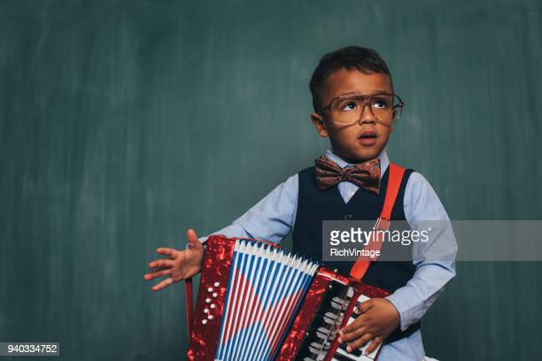 young retro nerd boy playing accordion - accordion stock pictures, royalty-free photos & images