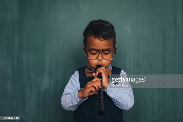 Young Retro Nerd Boy Playing Recorder