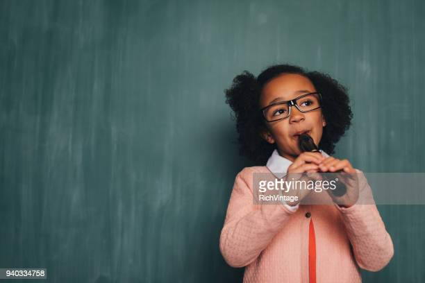 young retro nerd girl playing recorder - recorder musical instrument stock photos and pictures