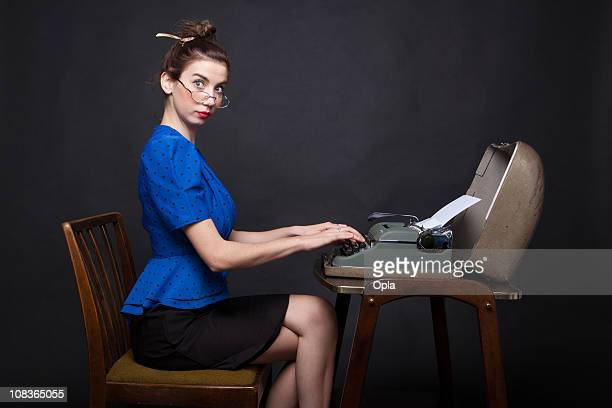Young retro secretary typing
