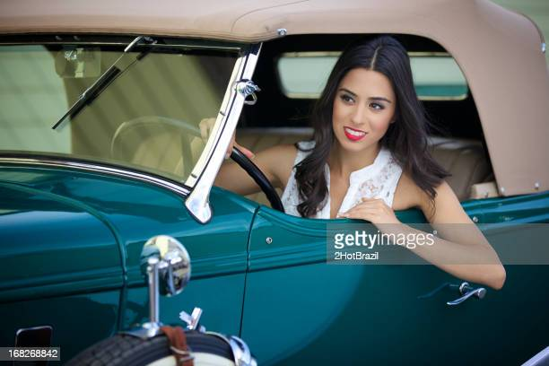 Young Retro Woman Driving a Vintage Car