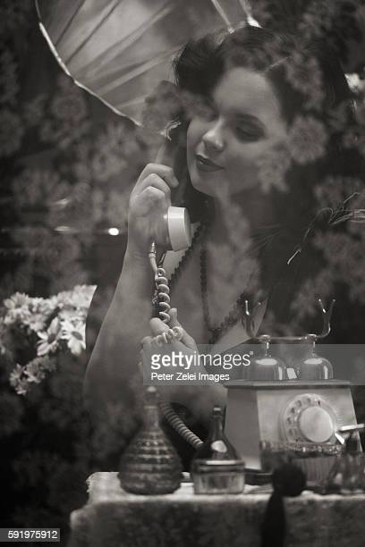 young retro woman talking on the phone - picture of phonograph stock photos and pictures