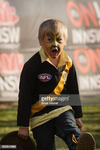 A young Richmond Tigers fan celebrates the Tigers win in the AFL Grand Final at the 2017 Deni Ute Muster on September 30 2017 in Deniliquin Australia...