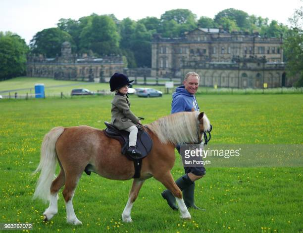 A young rider and her horse are led around the field before competing during the Duncombe Park Country Fair on May 28 2018 in Helmsley England Set in...
