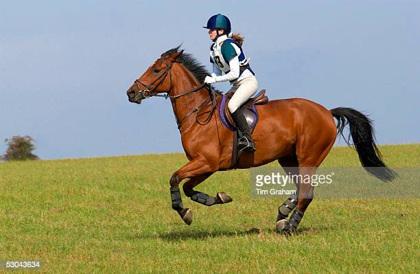 Young rider competing in cross country equine event in Oxfordshire with her own horse called Travis A Cleveland Bay cross Thoroughbred breed