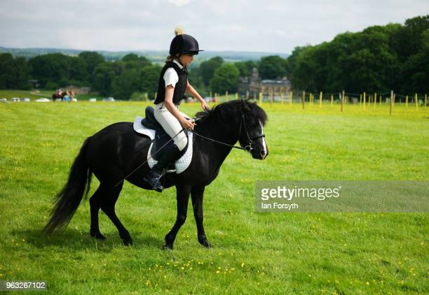 A young rider exercises her horse during the Duncombe Park Country Fair on May 28 2018 in Helmsley England Set in the grounds of one of Yorkshire's...