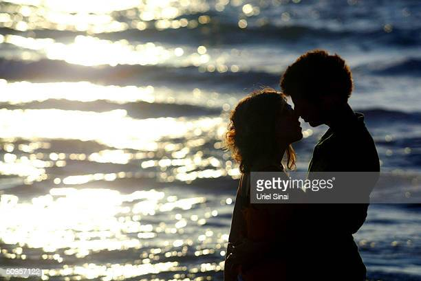 Young rightwing Jewish settlers kiss as they stand on the beach at the Gush Qatif settlement bloc June 13 2004 in the southern Gaza Strip Thousands...