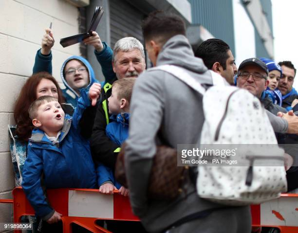 A young Rochdale fan boos Tottenham Hotspur's Erik Lamela as he arrives before the Emirates FA Cup Fifth Round match at the Crown Oil Arena Rochdale