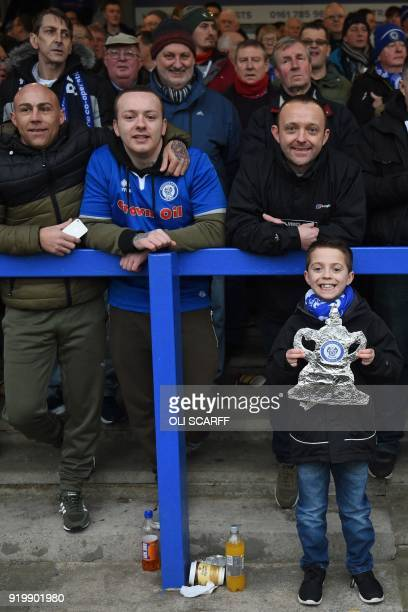 A young Rochdale fan holds up his tin foil FA Cup as supporters await kick off in the English FA Cup fifth round football match between Rochdale and...