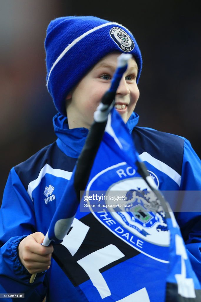 A young Rochdale mascot waves his flag before The Emirates FA Cup Fifth Round match between Rochdale AFC and Tottenham Hotspur at Spotland Stadium on February 18, 2018 in Rochdale, England.