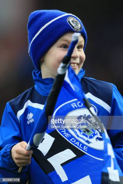 A young Rochdale mascot waves his flag before The Emirates FA Cup Fifth Round match between Rochdale AFC and Tottenham Hotspur at Spotland Stadium on...