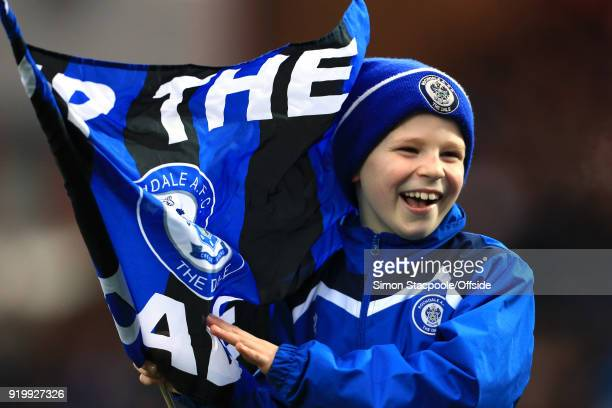 A young Rochdale waves his flag during The Emirates FA Cup Fifth Round match between Rochdale AFC and Tottenham Hotspur at Spotland Stadium on...