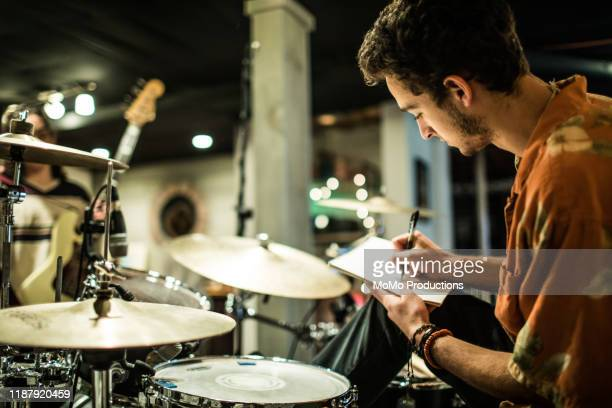 young rock band writing music together - komponist stock-fotos und bilder
