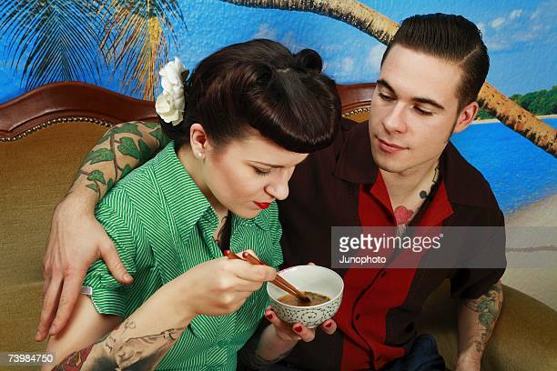 Young rockabilly couple sitting together