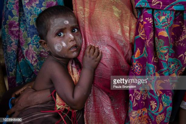 A young Rohingya boy waits in line for a food distribution of super cereal at Action Against Hunger Action Contre La Faim in Kutupalong camp on...