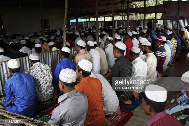 Young Rohingya refugees offer Eid AlFitr prayer in the moring at a refugee camp in Ukhia district near Cox's Bazar on June 5 2019 Muslims around the...