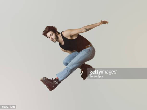young roller blade skater jumping - inline skate stock photos and pictures
