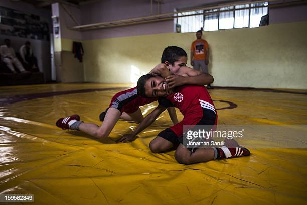 Young romangreco style wrestlers practice at a private club in old city July 23 2012 in Kabul Afghanistan Wrestling is a popular sport in Kabul with...