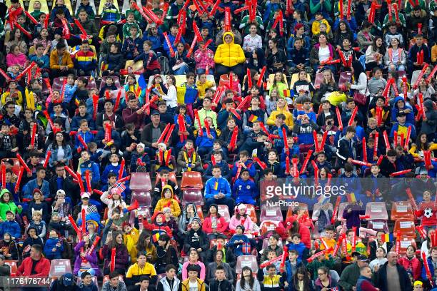 Young romanian fans support their team during the game during the UEFA Euro 2020 qualifier match between Romania and Norway at Arena Nationala on...