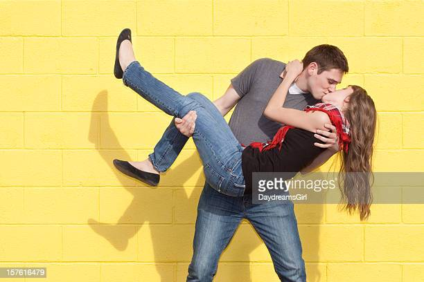 young romantic couple and yellow brick wall - dipping stock photos and pictures