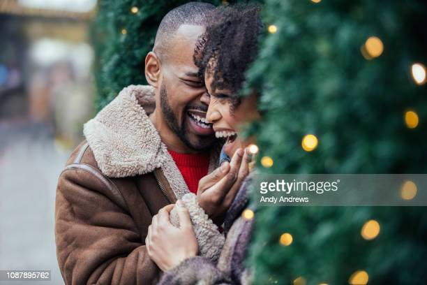young romantic couple at christmas - endast vuxna bildbanksfoton och bilder