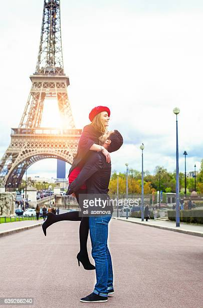 Young romantic couple enjoying near the Eiffel Tower in Paris
