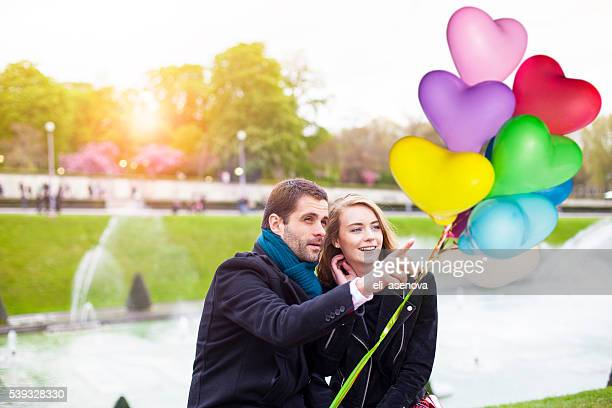 Young romantic couple having a date at Eiffel tower fountain