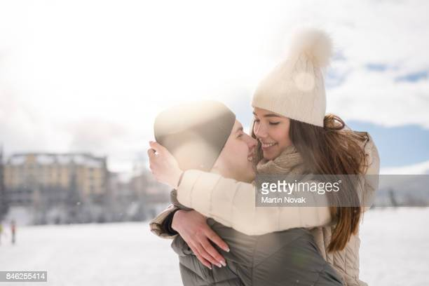 young romantic smiling couple hugging each other - winter coat stock pictures, royalty-free photos & images