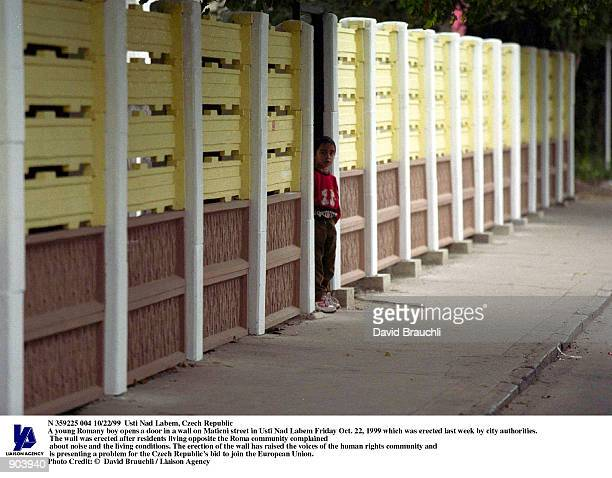 A young Romany boy stares out on Maticni street in Usti Nad Labem Friday Oct 22 1999 near a wall erected last week by city authorities The wall was...