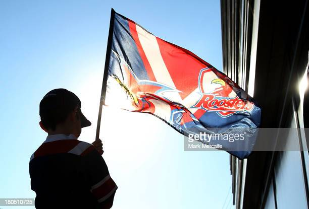 A young Roosters fan waves a flag before the NRL Elimination Final match between the Cronulla Sharks and the North Queensland Cowboys at Allianz...