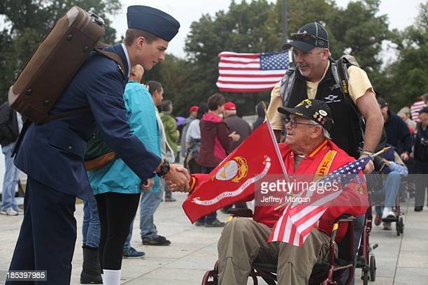 CONTENT] Young ROTC Cadet shakes the Hand of WWII Veteran WWII Honor Flight form Pugent Sound arrives at memorial during Govt Shutdown 101313 Million...