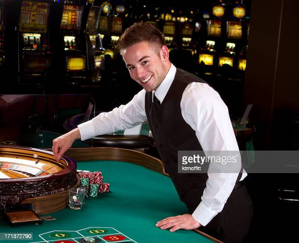 Young Roulette Dealer In A Casino