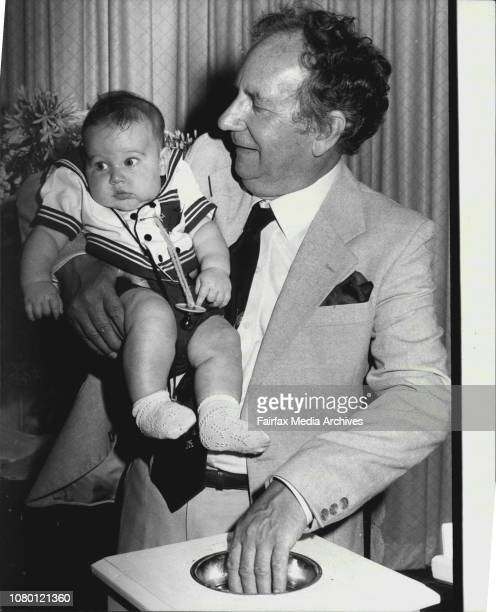 Young Rudolph Augustus Enrico Krall just four months old seems to be objecting to his haming ceremony conducted by the Rev Ted Noffs at the Wayside...