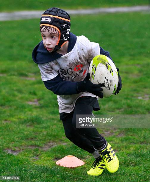 A young rugby player runs with the ball during the HSBC Youth Rugby Festival at David Lam Park March 9 2016 in Vancouver British Columbia Canada The...