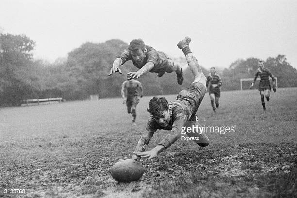 A young rugby player scoring a dramatic try during a local final