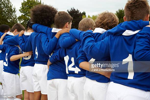Young rugby players from behind