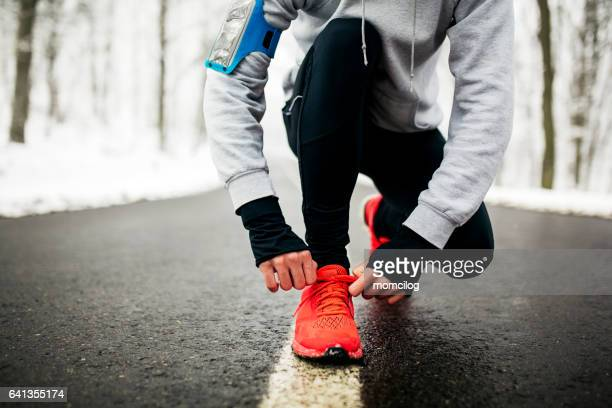 young runner tying his shoelaces - obscured face stock pictures, royalty-free photos & images
