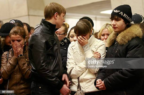 Young Russian girl cries while commemorating the victims of the terrorist metro blasts inside the Lubyanka metro station in Moscow on March 30, 2010....