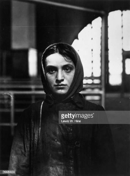 Young Russian Jewish immigrant at Ellis Island, New York.