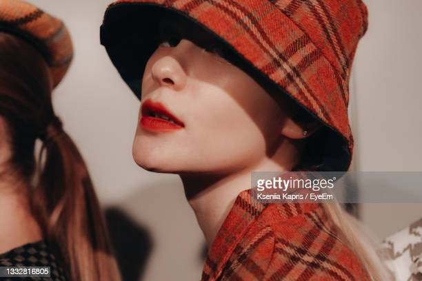 young russian model with red lips in stylish designer hat posing on the backstage - fashion week stock pictures, royalty-free photos & images