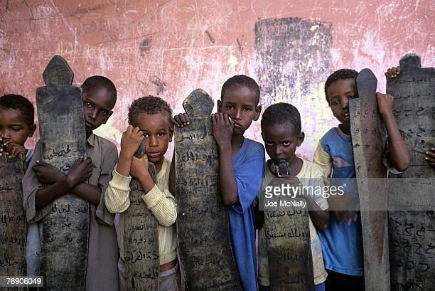 Young Rwanda boys pose with grave stones in their grasp in December of 1996 in Rwanda Africa In 1994 Rwanda saw one of the worlds worst act genocide...